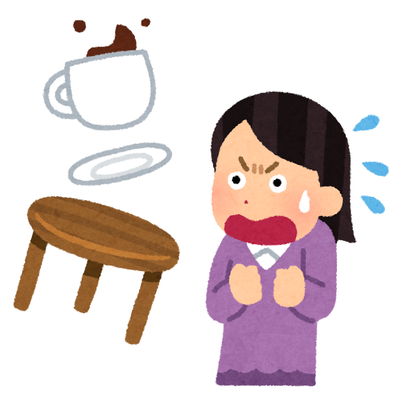 コーヒーをひっくり返して驚く女性